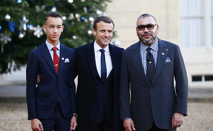 Morocco's King Mohammed VI, accompanied by Crown Prince Moulay El Hassan and France's President Emmanuel Macron.