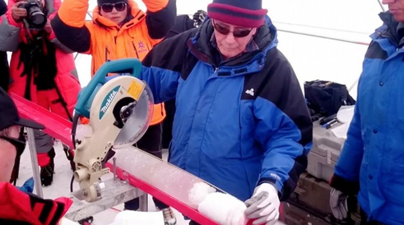 Lonnie Thompson, Distinguished University Professor in the School of Earth Sciences at The Ohio State University, cuts an ice core retrieved from the Guliya Ice Cap in the Kunlun Mountains in Tibet in 2015. Credit Photo by Giuliano Bertagna, courtesy of the Byrd Polar and Climate Research Center.