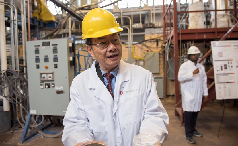 L.S. Fan, Distinguished University Professor in Chemical and Biomolecular Engineering at The Ohio State University, holds samples of materials developed in his laboratory that enable clean energy technologies. Credit Photo by Jo McCulty, courtesy of The Ohio State University.