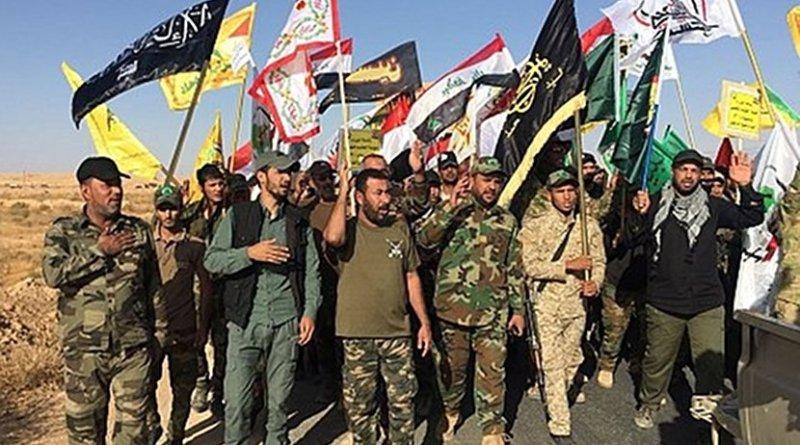 Hashd al-Sha'bi militia fighters parading after the liberation of al-Qaim village, Nov. 3, 2017. Photo via Syria Comment.