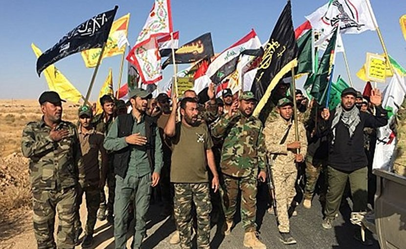 Hashd al-Sha'bi militia fighters parading after the liberation of al-Qaim village, Nov. 3, 2017. Photo via Syria Comment.