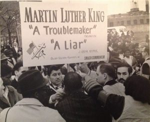 MLK in center back to camera, Morganstern is behind the poster, partially hidden