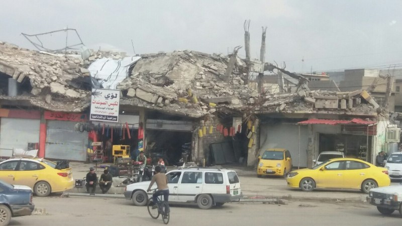Shop remains open in area of Mosul decimated by bombing, March, 2018. Photo: Abu Mohammed.
