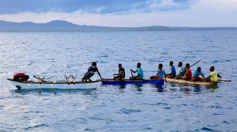 Young men in canoes in Northwest Malakula, Vanuatu. Credit Russell Gray & Heidi Colleran