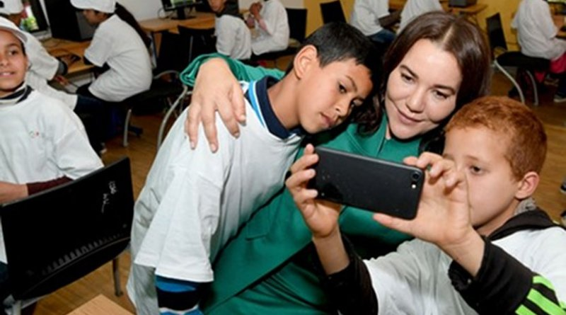 Princess Lalla Hasna of Morocco with students.