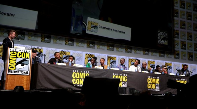 (L:R) Moderator Chris Hardwick, Feige, Coogler, and the cast of Black Panther at the 2017 San Diego Comic-Con. Photo Credit: Gage Skidmore, Wikipedia Commons.