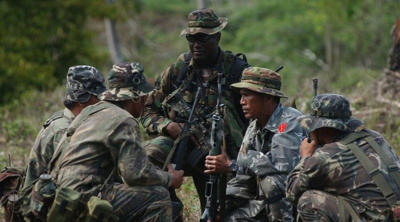 A Special Forces Soldier conducts Security Assistance Training for members of the Philippine Army's 1st Infantry (TABAK) Division. Photo by Edward G. Martens, Wikipedia Commons.