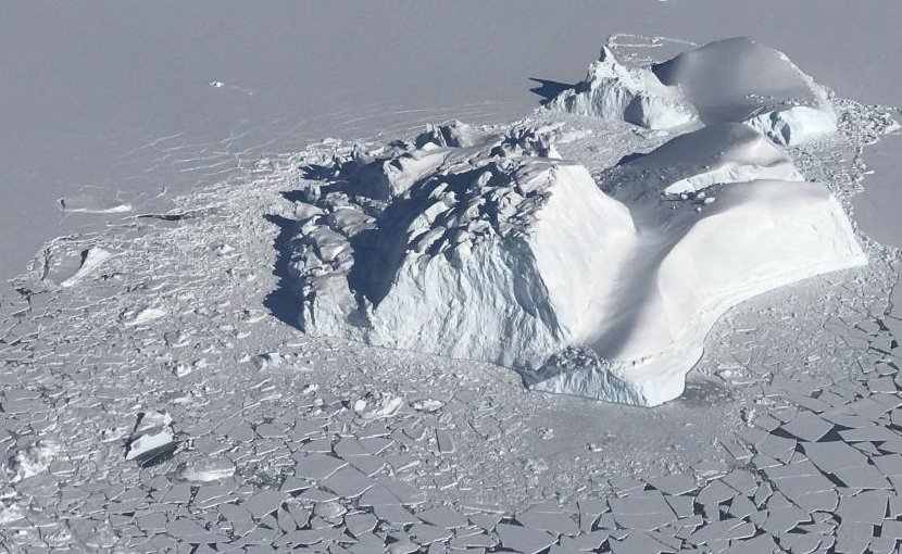 A large iceberg floating among sea ice floes, as seen during an operation IceBridge survey flight on Apr. 21, 2018. Credits: NASA/Linette Boisvert Credit Credits: NASA/Linette Boisvert