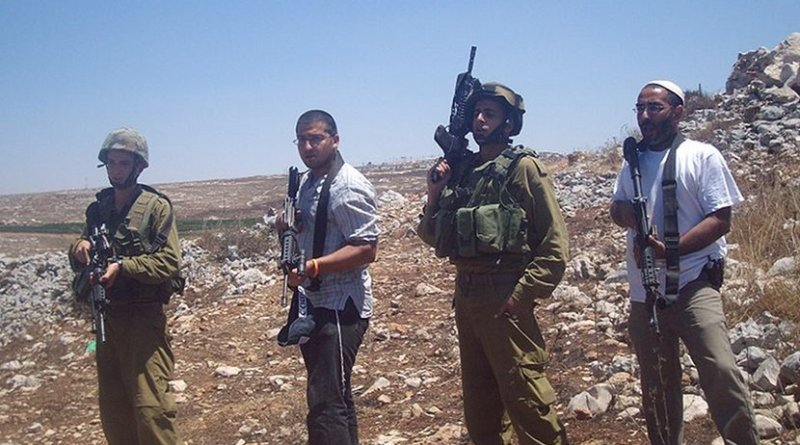IDF soldiers and Israeli settlers. Photo by ISM Palestine, Wikimedia Commons.