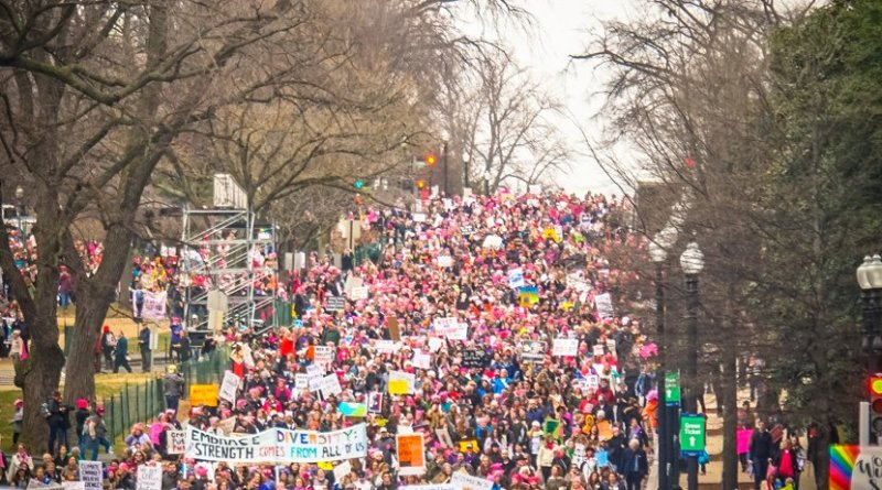 People taking part of the 2017 Women's March on DC the day after Donald Trump's inauguration. Photo by Ted Eytan, Wikimedia Commons.
