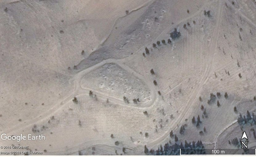 A 2013 CNES/Airbus satellite image of a new site that could be identified because looting pits over the site are visible on high-resolution satellite imagery. Credit Map data ©2018 Google.