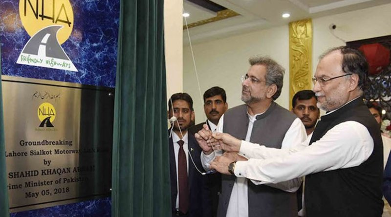 Interior Minister Ahsan Iqbal (right) and Prime Minister Shahid Khaqan Abbasi perform a ground-breaking ceremony for a motorway project on May 5. (Photo courtesy of Press Information Department, Government of Pakistan)