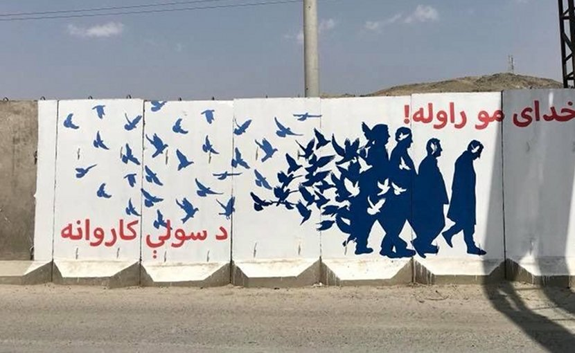 "One of several murals being created by Kabul's ""ArtLords"" painters to welcome the Helmand to Kabul peace walkers."