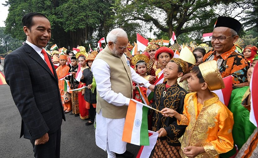 The President of Indonesia, Mr. Joko Widodo welcomes the Prime Minister, Shri Narendra Modi, on his arrival at Istana Merdeka, in Jakarta, Indonesia. Photo Credit: India PM office.