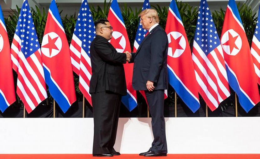 President Donald J. Trump and North Korean leader Kim Jong Un, shake hands as they meet for the first time, Tuesday, June 12, 2018, at the Capella Hotel in Singapore. (Official White House Photo by Shealah Craighead)