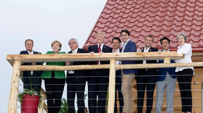 Leaders of the G7 at Black Bear Chalet in La Malbaie, Quebec, before their Working Dinner. From left are: Council President of the European Union Donald Tusk; Chancellor Angela Merkel of Germany; Commission President of the EU Jean-Claude Juncker; President Donald J. Trump; Prime Minister Giuseppe Conte of Italy; Prime Minister Justin Trudeau of Canada; President Emmanuel Macron of France; Prime Minister Shinzo Abe of Japan, and Prime Minister Theresa May of the United Kingdom. (Official White House Photo by Shealah Craighead)