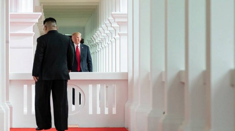 President Donald J. Trump watches as North Korean leader Kim Jong Un, walks toward him for their first-ever meeting, Tuesday, June 12, 2018, at the Capella Hotel in Singapore. (Official White House Photo by Stephanie Chasez)
