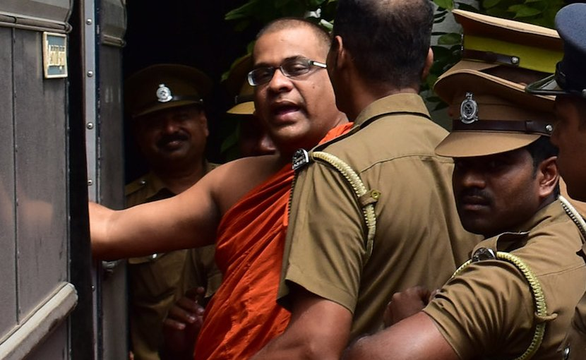 Buddhist monk Galaboda Aththe Gnanasara Thera being escorted to a prison bus after his sentencing by Homagama Court on June 14. (Photo by S. Kumar/ucanews.com)