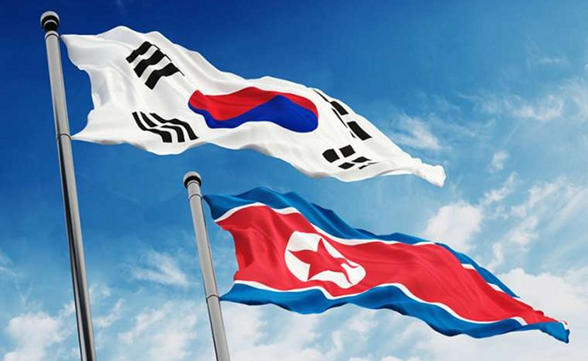 North and South Korea flags. Credit: cigdem/Shutterstock.