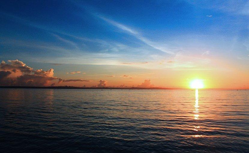 Sunset in East Java, Indonesia. Photo Credit: Benedictus Raflin, Wikipedia Commons.