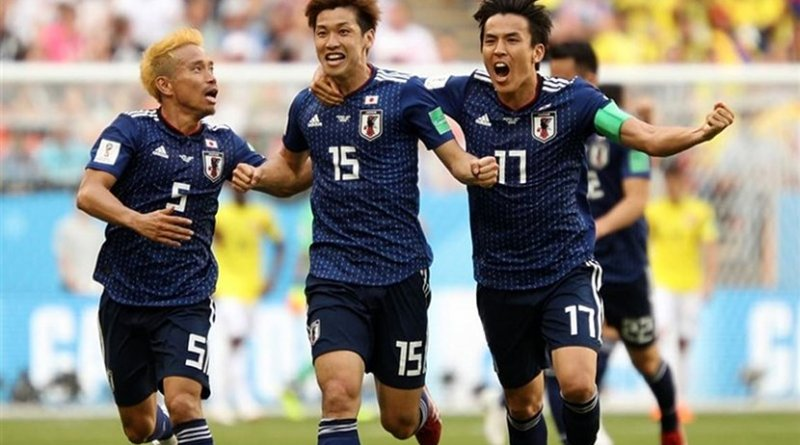 Football players for Japan celebrate in 1-2 victory over Colombia in 2018 World Cup. Photo Credit: Tasnim News Agency.