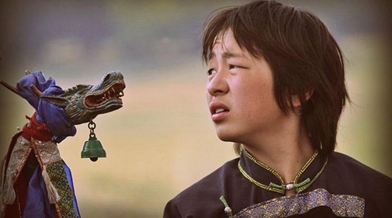 A Buryat boy in a shaman ritual in Siberia, Russia. Photo Credit: Аркадий Зарубин, Wikimedia Commons.