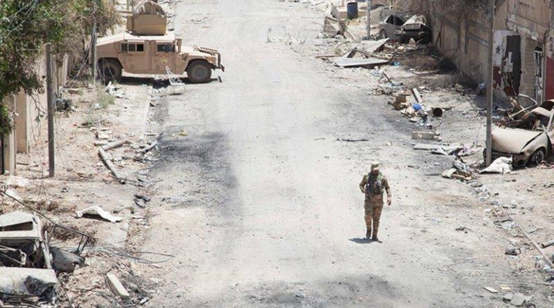 Iraqi Security Forces member provides security near patrol base in Mosul, June 22, 2017 (U.S. Army/Rachel Diehm)