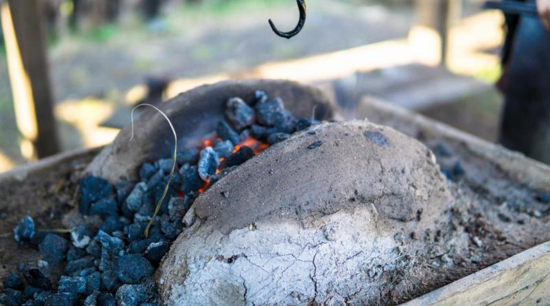 Blacksmith furnace with burning coals, tools, using Medieval techniques Credit Shutterstock