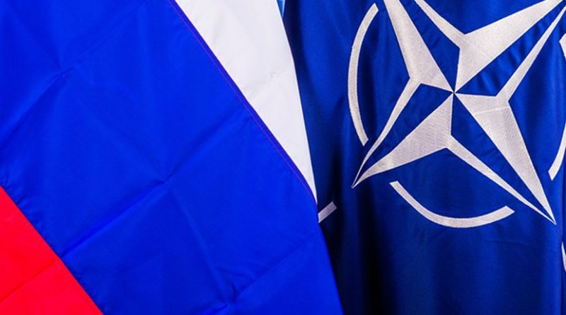 Flags of Russia and NATO. Photo Credit: NATO.