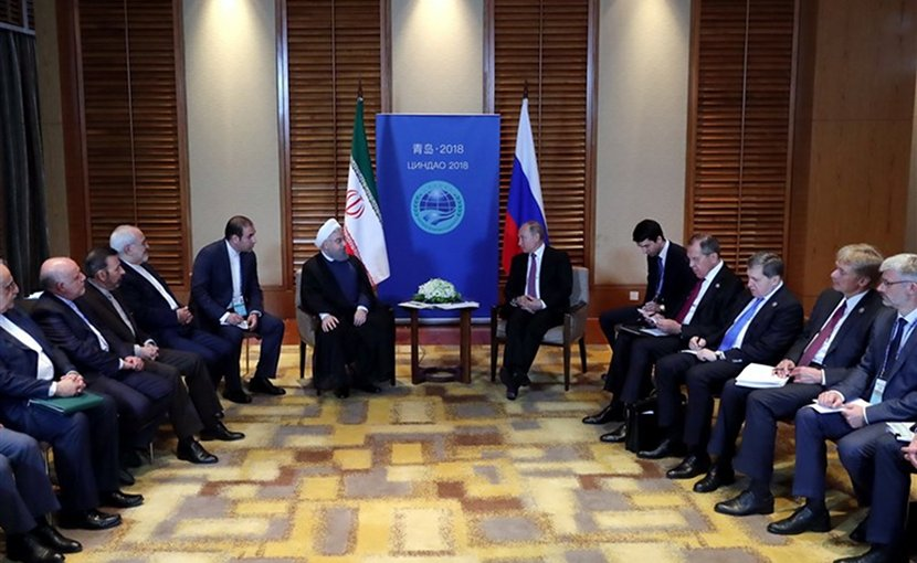 Iranian President Hassan Rouhani and his Russian counterpart Vladimir Putin on the sidelines of the Shanghai Cooperation Organization summit in China's Qingdao. Photo Credit: Tasnim News Agency.