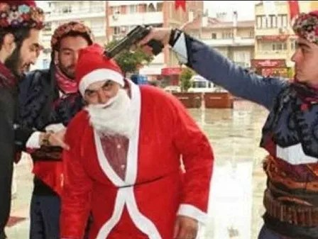 The ultra-nationalist Islamist group Alperen Hearths staged a forced conversion of Santa Claus to Islam, putting a gun to the head of an actor dressed as Santa Claus. This photograph was then posted on Twitter.