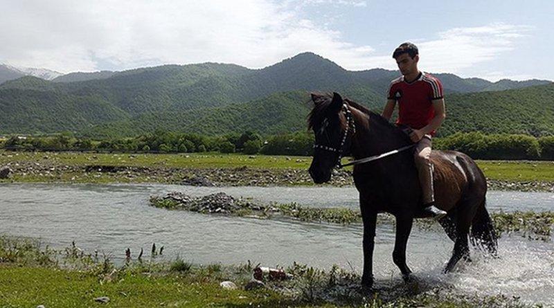 Pankisi Gorge in Georgia, Kist boy with horse. Photo Credit: Sulkhan Bordzikashvili, Wikimedia Commons.