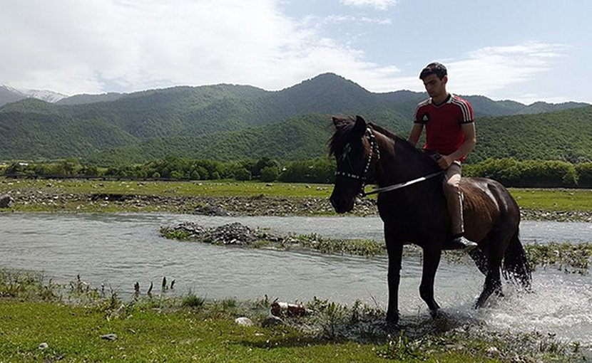 Pankisi Gorge in Georgia, Kist boy with horse. Photo Credit: Sulkhan Bordzikashvili, Wikimedia Commons.