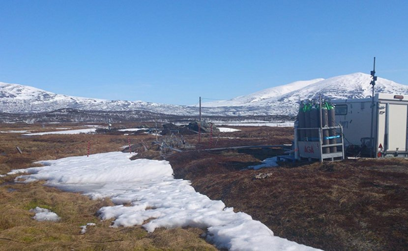 Stordalen Mire study site. The biogeochemistry hut is connected to autochambers, allowing measurements of gas flux. Credit Caitlin Singleton