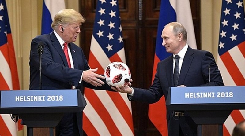 Russia President Vladimir Putin hands US President Donald Trump 2018 World Cup soccer ball. Photo Credit: Kremlin.ru