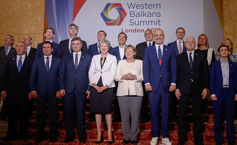 Attendees of the Western Balkans Summit 2018, including British Prime Minister Theresa May and Germany's Chancellor Angela Merkel pose for a 'family photo' at the Western Balkans Summit 2018 in London. Photo: EPA-EFE/LUKE MACGREGOR/POOL