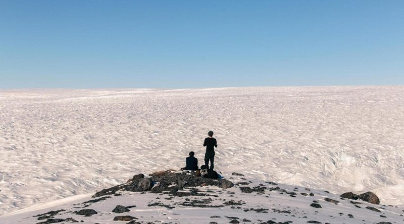 Researchers from the Bristol Glaciology Centre look over the vast Greenland Ice Sheet, which stretches beyond the horizon, during a field campaign lasting over three months in 2015. The researchers camped in a remote region of Greenland, monitoring a large meltwater river and taking samples to look at the silica concentration and isotopic signature. Credit Dr Jon Hawkings, University of Bristol