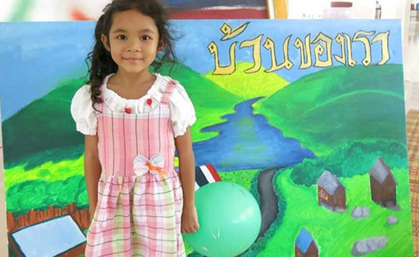 "An art camp in Loei Province with the painting of UNITE Thailand on the theme of ""our home"" done by Archee. photo: Rattana Lao"