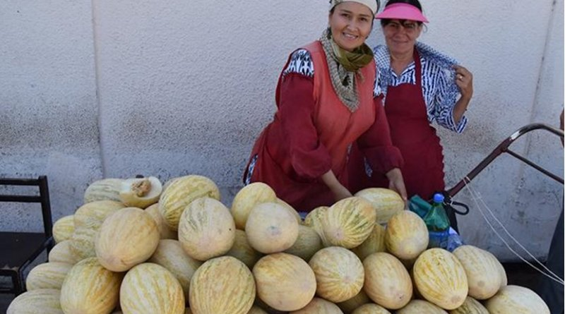 Vendors in every Central Asian bazaar sell a diverse array of melons. These two women in the Bukhara bazaar are selling a variety akin to the famous Hami melons of Xinjiang. There is a great deal of regional pride associated with specific varieties of landrace melons. Credit Robert Spengler