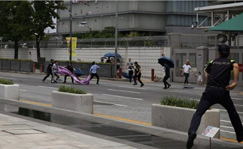 South Korean 'Youth Resistance' protests at the US embassy in Seoul demanding a permanent peace treaty and normalizing relations with North Korea. Photo via Popular Resistance.