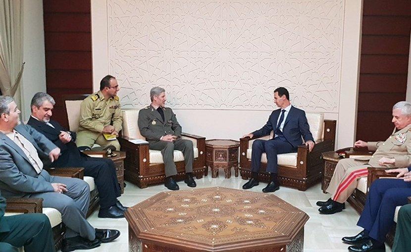 Iranian Defense Minister Brigadier General Amir Hatami meets with Syrian President Bashar al-Assad. Photo Credit: Tasnim News Agency
