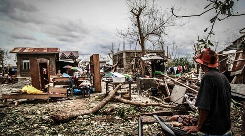 A man looks at the remains of his home after Typhoon Mangkhut slammed through Cagayan province, the Philippines, Sept. 16, 2018. Photo Credit: Karl Romano/BenarNews