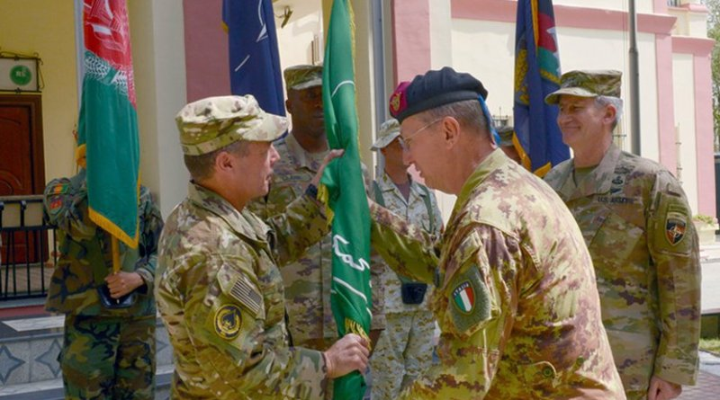 Italian army Gen. Riccardo Marchio, right, commander of NATO's Allied Joint Force Command Brunssum, passes the Resolute Support Mission flag to U.S. Army Gen. Austin S. Miller, the incoming Resolute Support Mission commander, during a change-of-command ceremony in Kabul, Afghanistan, Sep. 2, 2018. Air Force photo by Tech. Sgt. Sharida Jackson