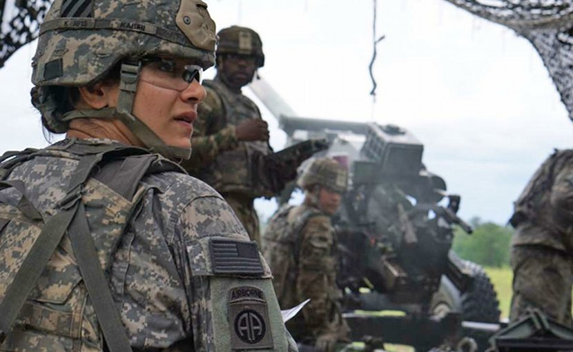 Army Capt. Nargis Kabiri, commander of Alpha Battery, 1st Battalion, 9th Field Artillery Regiment, 3rd Infantry Division Artillery, helps her team prepare an M119 Howitzer on Fort Stewart, Ga., Aug. 22, 2017. Army photo by Pfc. Zoe Garbarino