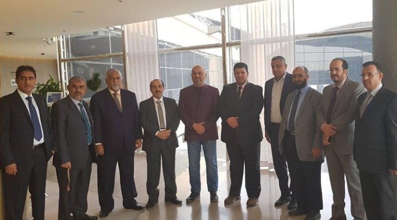 Yemeni Foreign Minister Khaled Al-Yamani (purple jacket) with the government delegation to Geneva. (Supplied)