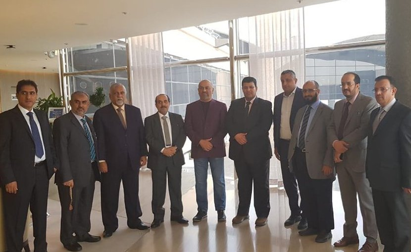 Yemeni Foreign Minister Khaled Al-Yamani (purple jacket) with the government delegation to Geneva. (Supplied)