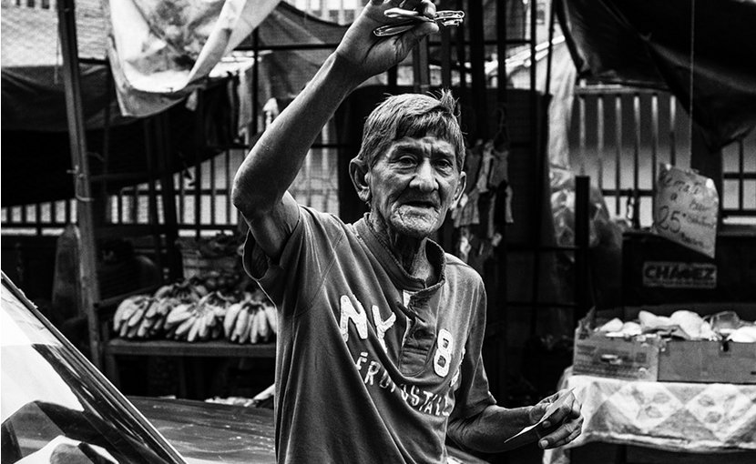 Old man selling razors in Maracaibo, Venezuela.