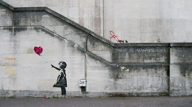 "Original mural of ""Balloon Girl"" by Banksy on Waterloo Bridge in South Bank in 2004. Photo Credit: Dominic Robinson, Wikipedia Commons."