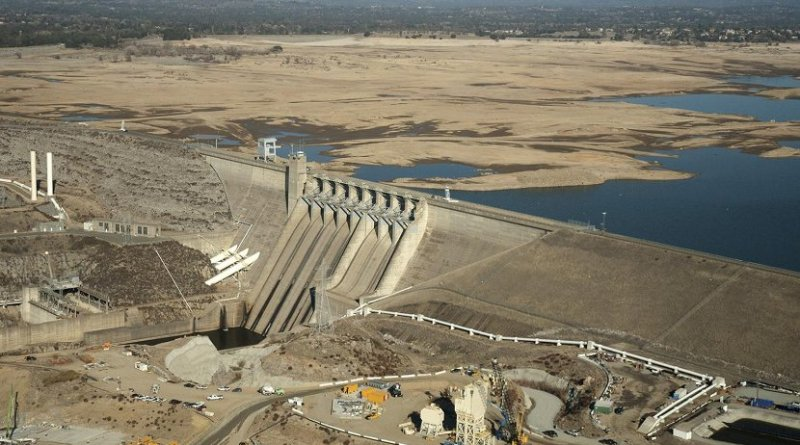 This photo is an aerial view of Folsom Dam and Lake in Sacramento County shows low water levels in January 2014. Credit Paul Hames/California Department of Water Resources