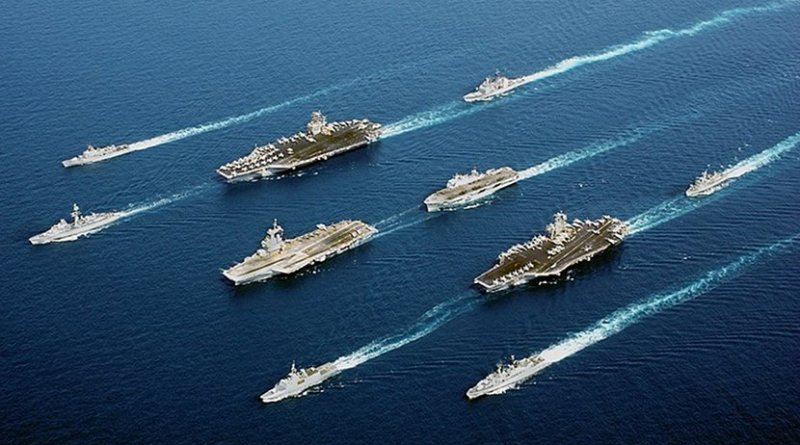 File photo of USS John C. Stennis (top left) in a 5-country multinational fleet, during Operation Enduring Freedom in the Oman Sea. Photo Credit: US Navy